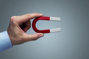 Hand holding magnet