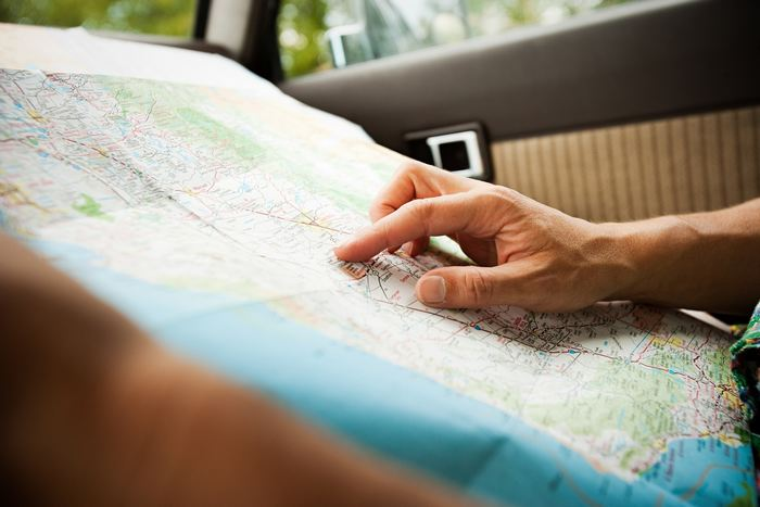 Person with a map / Sources Getty Images