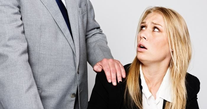 Harassment in the office: older man touches young businesswoman / Sources Getty Images